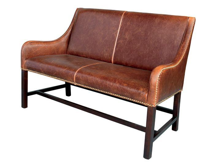 Необычный диван на высоких ножках с великолепной кожаной обивкой. Диван декорирован небольшими гвоздиками.             Метки: Маленькие диваны.              Бренд: Restoration Concept.              Цвета: Коричневый, Темно-коричневый.