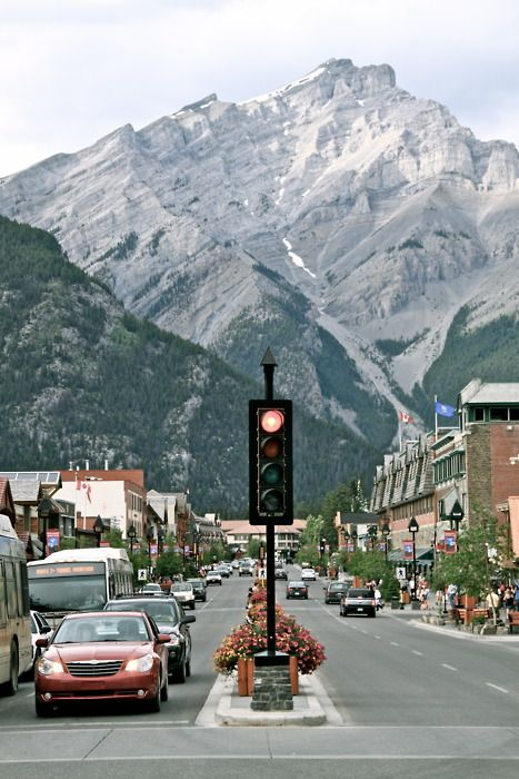 Banff, Alberta, Canada. This is a cute little town, snuggled into the Rockies and a part of Banff Park. Lovely place!