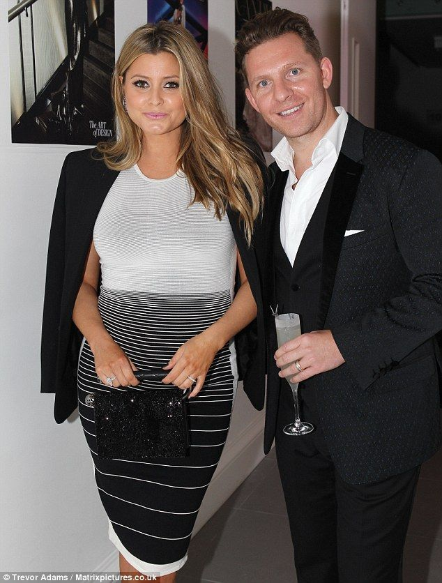 Yummy mummy to be: Featuring a white bodice and a subtle striped pencil skirt, Holly's stylish choice of garment proved an inspired choice a...