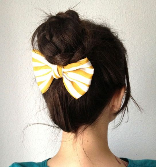 Bow & braided bun...too cute... put a clip on the back of bow and I can even do this with short hair and use the bow to clip up shorter pieces