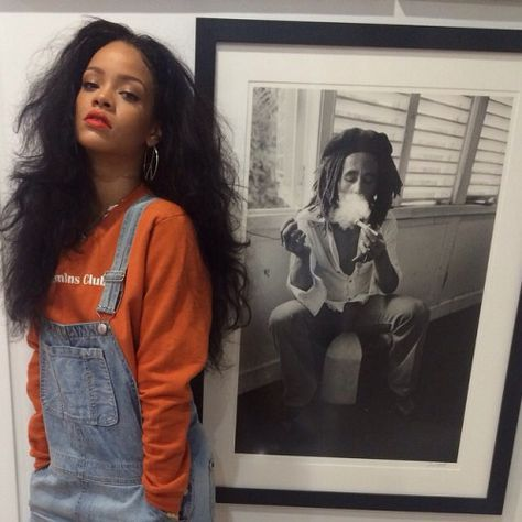 Rihanna in jean overalls. Bob Marley photo. Behind the scenes.