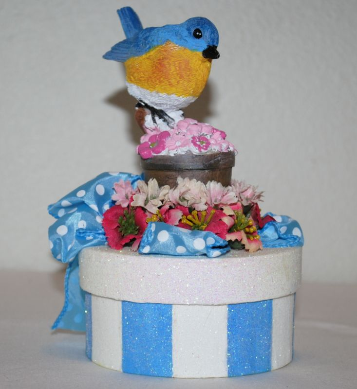 """""""The Michele"""" GIFT BOX/Cake Topper....Bright blue and white stripes, pink flowers, a blue and white polka dot ribbon adorn this yellow breasted, plump little blue bird enjoying a spring day. This GIFT BOX is perfect for a GIFT CARD, some jewelry or some other small gift for a loved one and then,they get the GIFT BOX to keep as a treasured keepsake.......$20  #decoratedgiftboxes #handmadegiftboxes #decoratedboxes"""