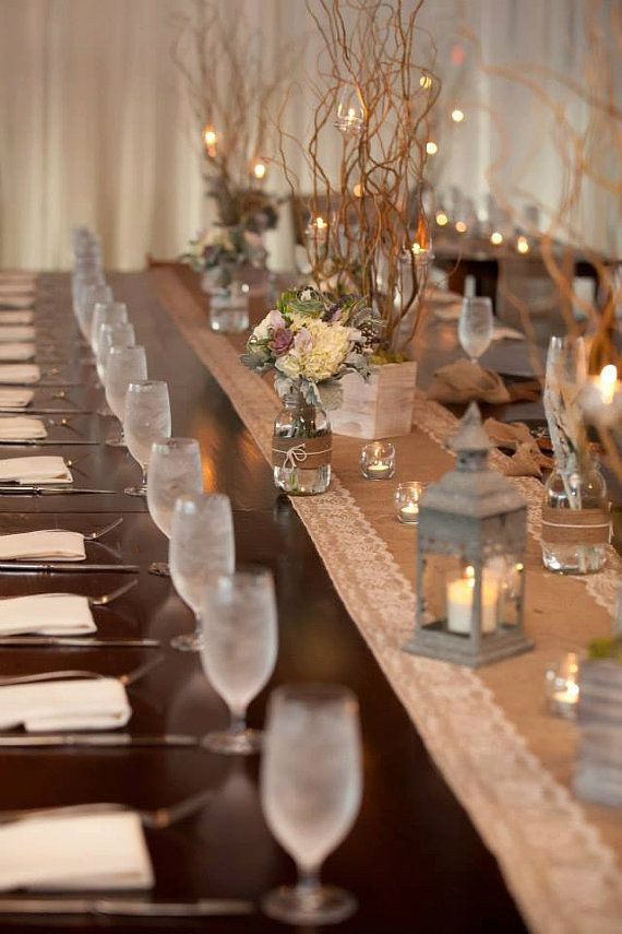 Rustic Wedding tablescape: Burlap and Lace Table Runners with Natural Color Lace, burlap- and twine-covered mason jars with flowers and driftwood, country style lanterns, manzanita branch centerpieces.