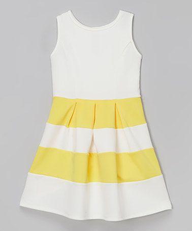 Look at this #zulilyfind! Ivory & Yellow Spring Box Pleated Dress - Girls #zulilyfinds