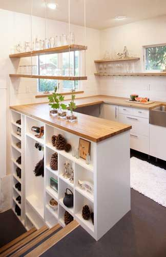 small kitchen with smart stairwell shelving - no upper cabinets (visible, anyway)