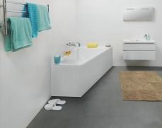Asymmetric bathtub. The toilet would be where the towels are hanging. The sink would be above the toilet. The door is where the sink is
