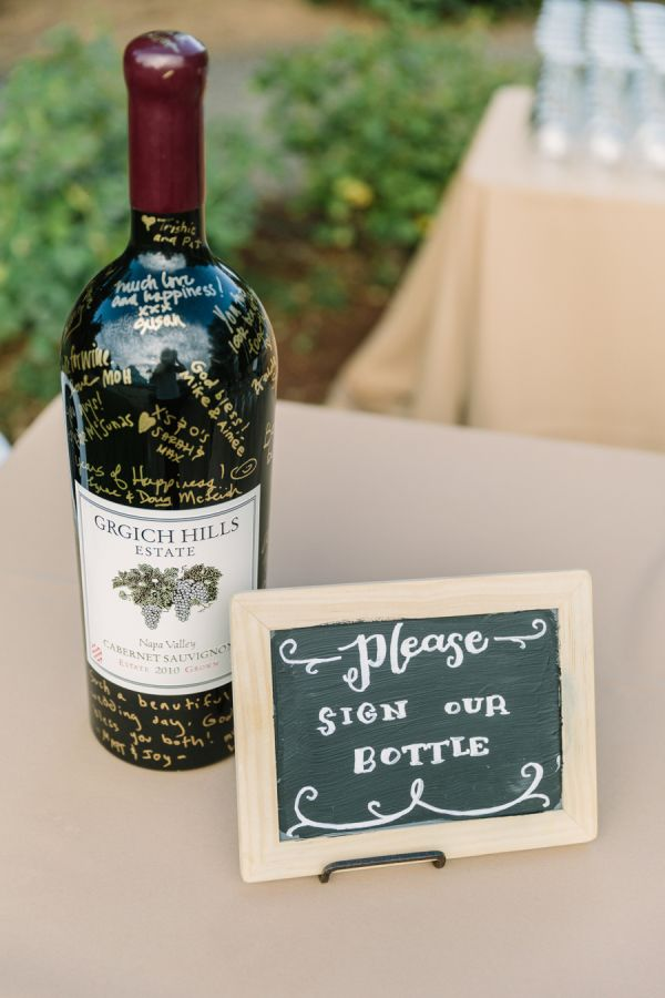 Having a vineyard wedding? Have guests sign a bottle of wine from your wedding year and save it for a future anniversary: http://www.stylemepretty.com/australia-weddings/new-south-wales-au/sydney/2015/08/27/16-creative-guest-book-alternatives-your-guests-will-want-to-sign/