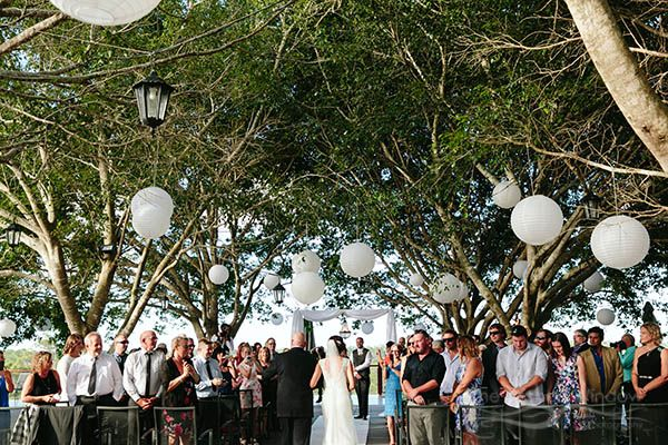 father and bride walk down aisle. Sirromet Winery wedding at the Tuscan Terrace.