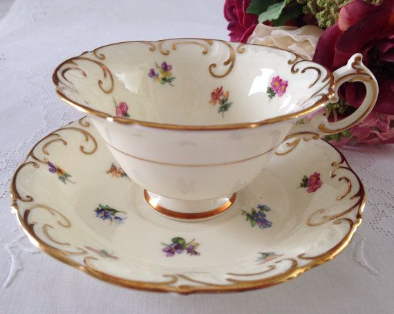 Vintage china tea cup and saucer, made by Paragon in  England. This duo is gorgeous, off white ground with tiny flower all over, both the cup and saucer