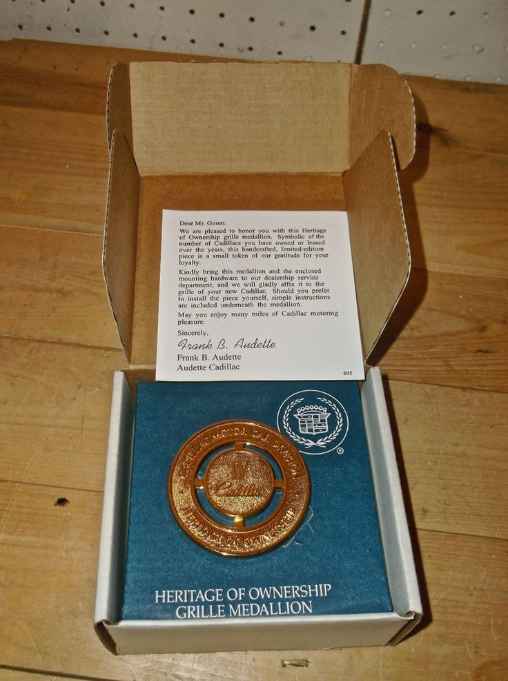 GOLD CADILLAC HERITAGE OF OWNERSHIP IV GRILLE MEDALLION BADGE EMBLEM RARE NEW