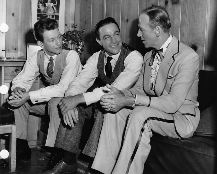 """One of the most famous musical classics, """"Singin' in the Rain"""" (1952), depicts Hollywood's transition from silent films to talkies. Here stars Donald O'Connor (left) and Gene Kelly (center) visit with Fred Astaire (right), who was starring in """"The Belle of New York,"""" which was in production at the same time."""