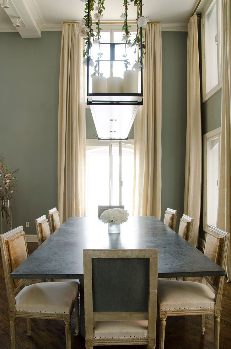 """""""Entertaining is something I really enjoy, but I want everyone to feel comfortable,"""" she says of her gray granite dining table and eighteenth-century chairs. She had the chairs re-covered in three different fabrics—including burlap—to make them look and feel more casual."""