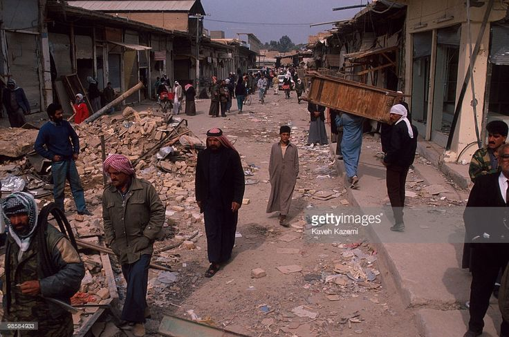 (1991) Iraqi people in the rubble after Allied bombers blasted a neighborhood in the center of Fallujah during the Gulf War, 19th February 1991.