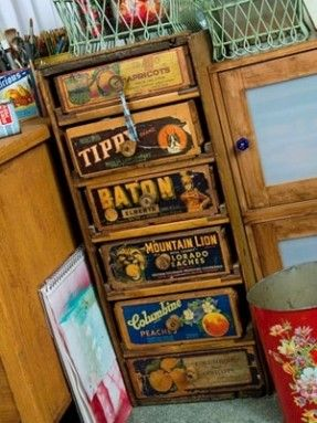 Antique fruit crates as drawers (though I have found real vintage fruit crate labels for very little - a DYI!)