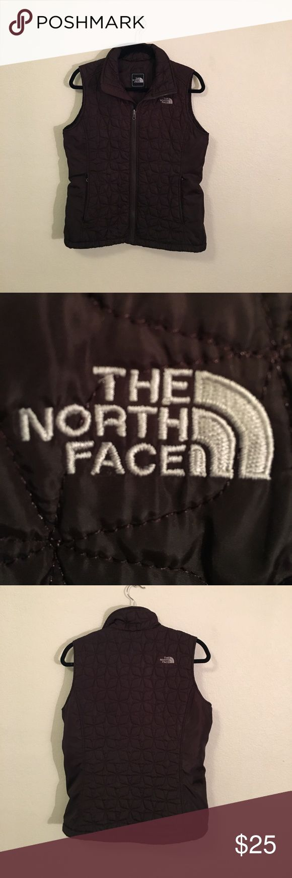 The North Face Vest! The North Face Vest.  Brown with beige decal.  Size Medium. Worn only a couple of times.  Good condition. No rips stains or tears. The North Face Jackets & Coats Vests