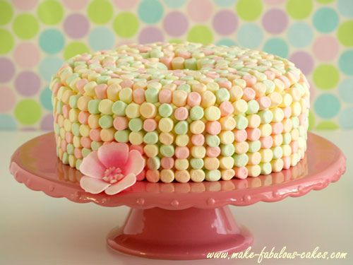 Easter Angel Food Cake - Frost and cover with marshmellows. For a shortcut-- get the ready made angel food cake at the grocery store.