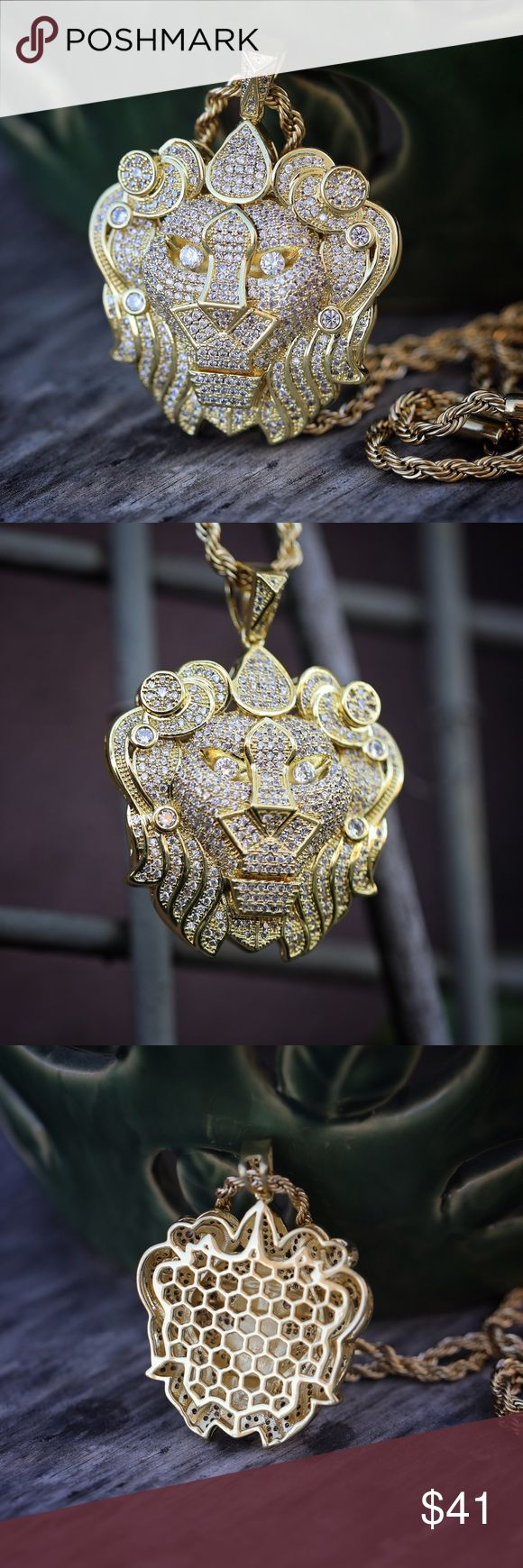 14k Gold Plated Lion Pendant Charm Necklace Iced Out 14k Gold Plated Lion Pendant Charm Necklace  Lion pendant is fully iced out with white lab simulated diamonds. Pendant size is 1.75 inches in length Chain is 14k gold plated over 316 stainless steel. This lion pendant comes with a 3mm width,20,22,24,26 or 30 inch 316 stainless steel 14k gold plated rope chain. TSV Jewelers Accessories Jewelry