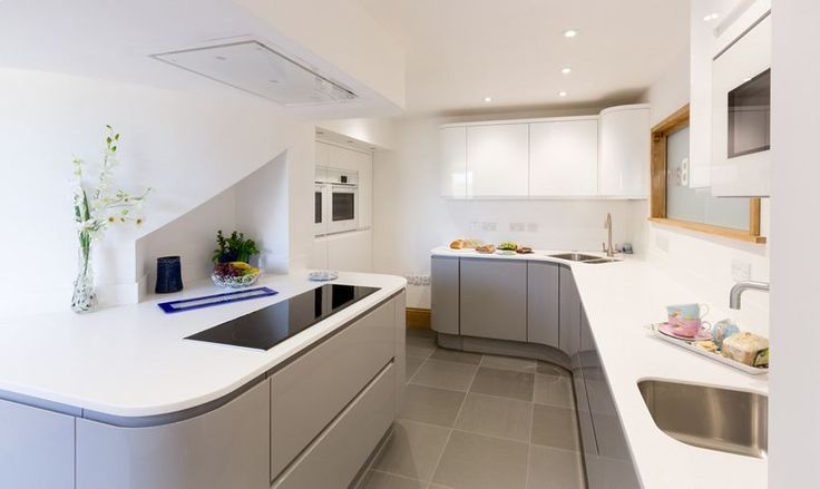 ATLANTIS KITCHENS PROJECT: Handleless Gloss Grey & White Kitchen - Curved kitchen units - White Corian worktops - Bosch and Air Uno appliances - Quooker boiling water tap - LED feature lighting - Karndean flooring