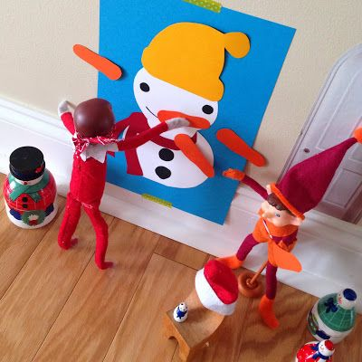 Elf on the Shelf playing pin the nose on the snowman