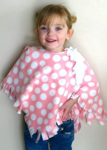 My mom called me the other day and told me about a little project that she made for her friend's daughter. She thought Kaylee would like it too. I agreed. It was a little no-sew fleece poncho…