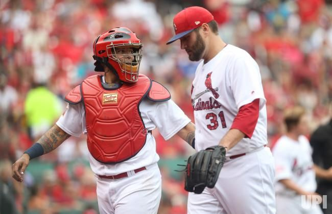 St. Louis Cardinals Yadier Molina talks with starting pitcher Lance Lynn in the second inning against the Miami Marlins at Busch Stadum in…