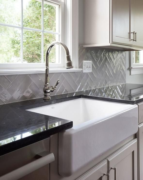 Large Gray Herringbone Tiles Bring A Dimensional Appeal To An Upgraded Kitchen Feat Modern White Kitchen Cabinets Black Quartz Countertops White Modern Kitchen
