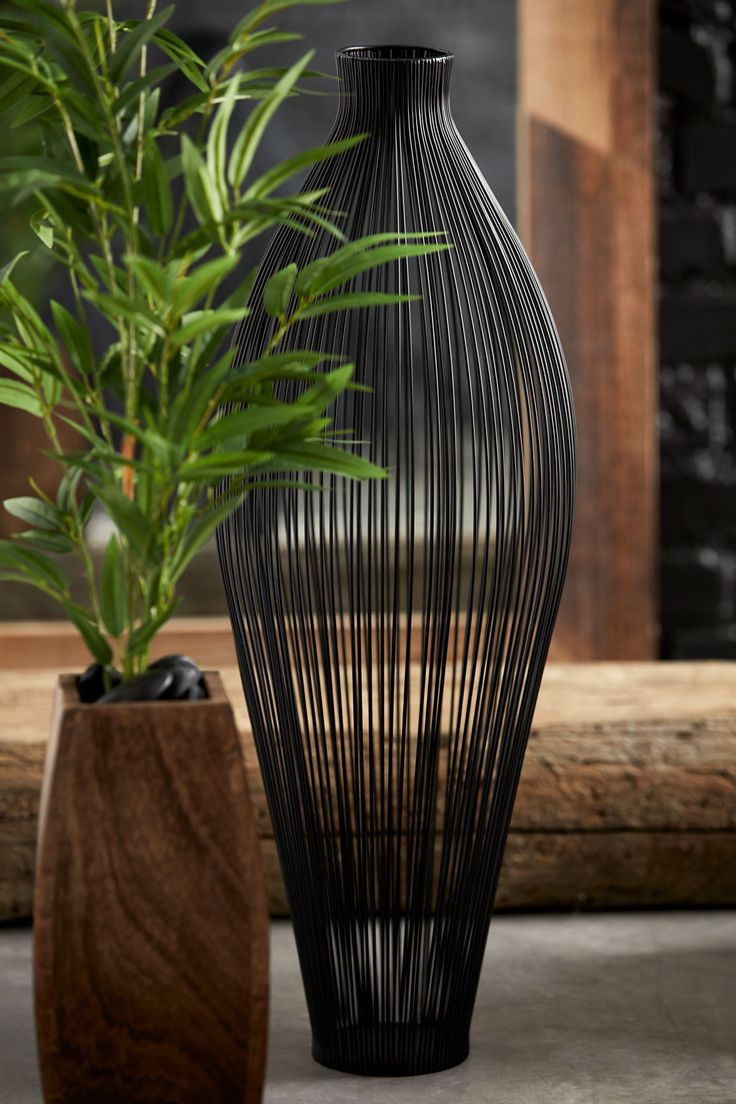 Introducing Home Garden. Lush foliage. Fresh new hues. Bring the outdoors in with our newest collection. This metal wire floor vase is perfect for your space along with your favorite flowers, a green accent leaf, or even left on its own.