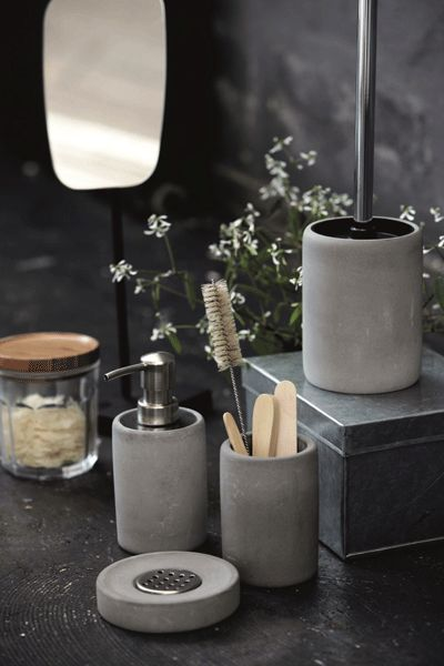 We are always on the hunt for fabulous accessories for the home and love this simple but striking concrete toothbrush holder Matching accessories