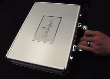2012-13 Panini Flawless basketball cards are being packed inside this metal briefcase.  At $1250 per box with 7 autographs inside and a diamond or emerald, I guess it's easy to see why.