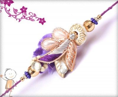 Fancy  #Rakhi Collection 2015 – Send  #Rakhi to #USA #UK #Canada #India #Australia  #Dubai  #NZ #Singapore.  Beautiful Violet Zardosi Rakhi, surprise your loved ones with roli chawal, chocolates and a greeting card as it is also a part of our package and that too without any extra charges. http://www.bablarakhi.com/send-fancy-rakhi-online/1145-send-beautiful-violet-zardosi-rakhi-online.html