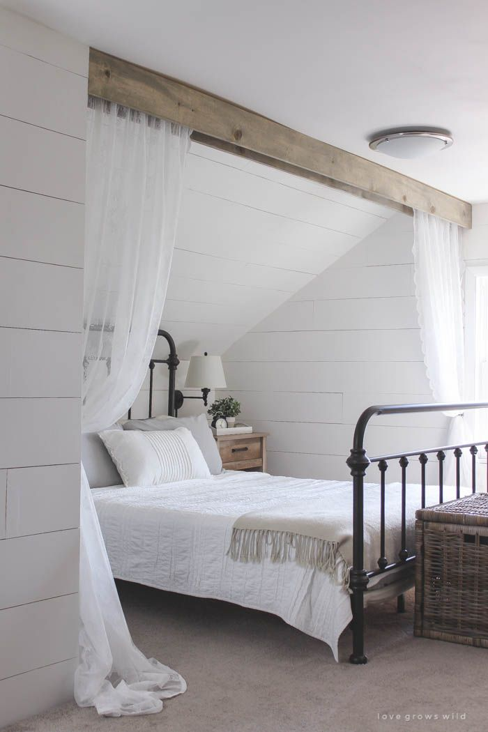 faux wood beam and lace curtains over the bed, and the results are amazing! See how to do this project in your home at LoveGrowsWild.com