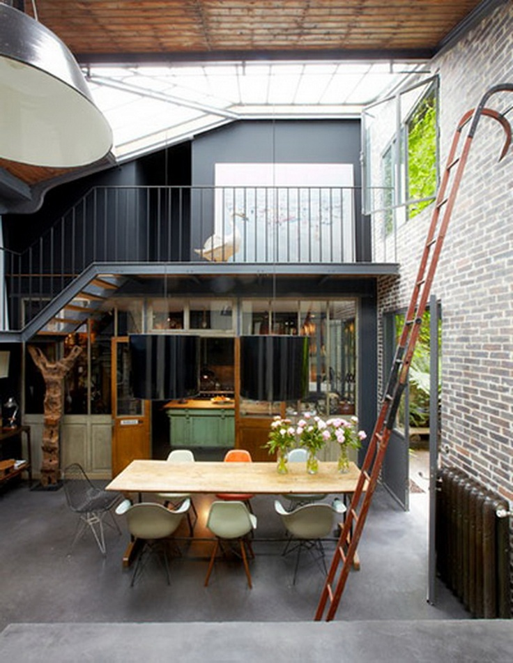 Vintage style Parisian industrial loft belonging to Isabelle Puech and Benoît Jamin.