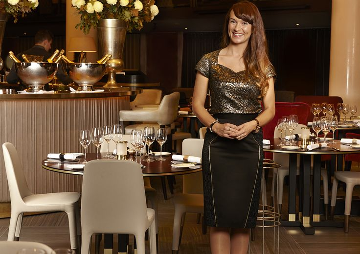 Moving down the iconic gold stairs and into the restaurant, the Head waitress is here in her Studio 104 uniform to greet you and show you to your table.