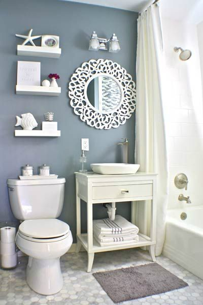 Use fluorescent lighting (softer and more even light).  nautical small bathroom design idea