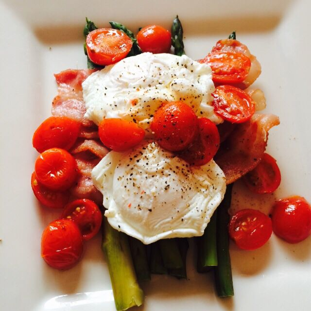 Poached eggs with asparagus, bacon and cherry tomatoes.. I'm so good though