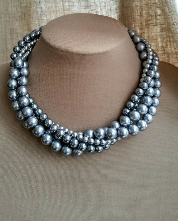 Check out this item in my Etsy shop https://www.etsy.com/ca/listing/268674232/multistrand-gray-mother-of-pearl-choker