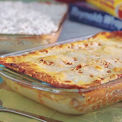Eggplant Parmesan Lasagna | Layers of thin-sliced eggplant replace the meat in this cheesy lasagna recipe. Use the eggplant within a day or two of purchase for the best flavor. | SouthernLiving.com