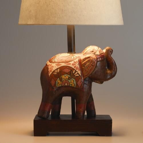 I think my daughter would like this. Discovered at WorldMarket.com: Indian Elephant Accent Lamp Base