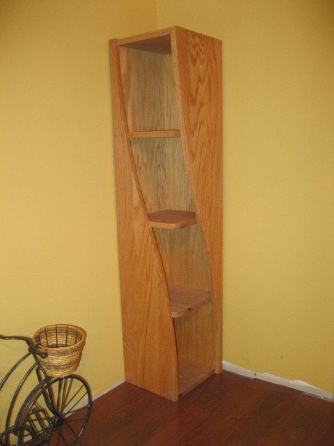 """Ok. Just go ahead and """"favorite"""" this guy's shop on Etsy.    Corner Shelf with a Twist by WoodCurve on Etsy, $325.00"""