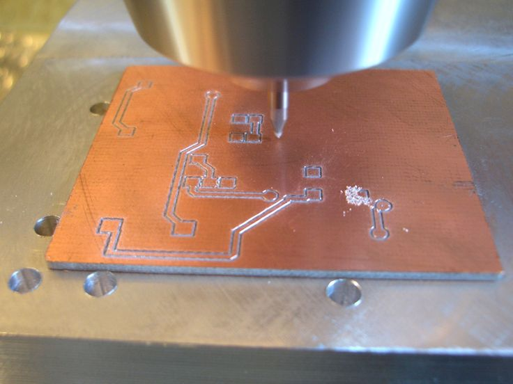 Milling isolation traces to make a printed circuit board. The layout is made with cadsoft eagle and the pcb-g-code script. The traces are 0.2mm wide and 0.1mm deep. [2048x1536]