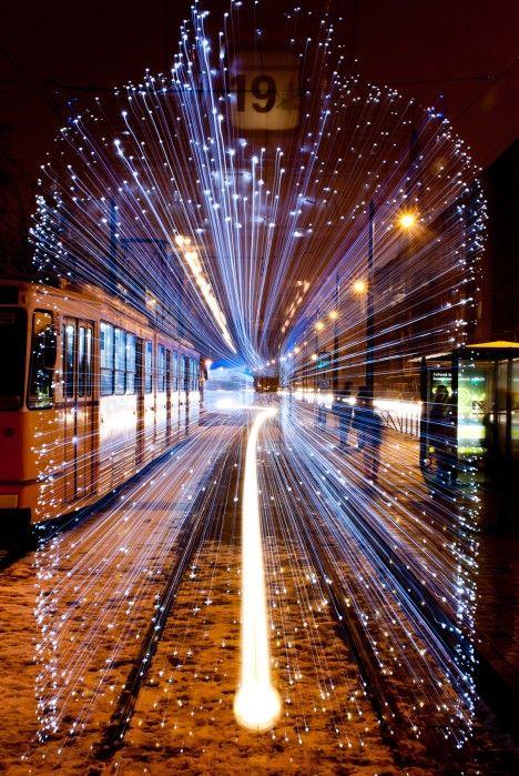 Time-Traveling Trams: 30,000 LED Lights Vanish Street Trains