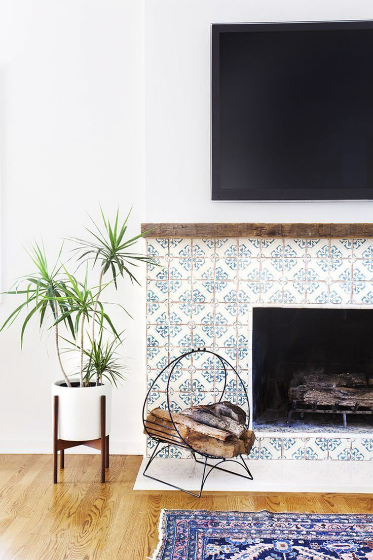 Beautiful tiling and wood around the fireplace.