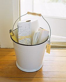 EssentialsFill a bucket with the basics any new house needs: light bulbs, an extension cord, paper towels, a tape measure. Include maps and other useful neighborhood information, such as trash-collection and recycling schedules, and train timetables. You might also want to type up a list of your recommendations for the best local dry-cleaner, grocer, hardware store, and pizza shop, among others.