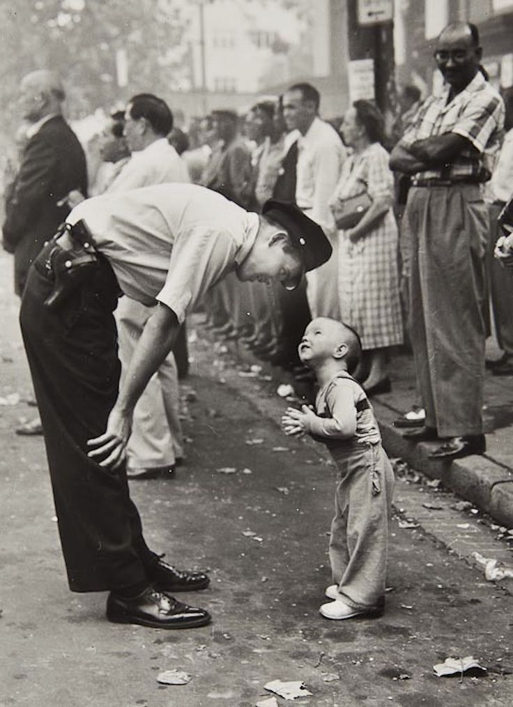 Faith and Confidence by William C. Beall for the Washington Daily News. 1958 Pulitzer Prize.    During a Chinese festival, officer Maurice Cullinane stooped down to coax tiny Allen Weaver back onto the curb to avoid the spluttering fireworks. The picture, widely reprinted, earned photographer Beall a Pulitzer Prize.