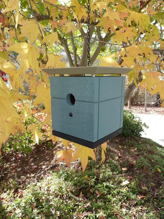A modern, cube-like birdhouse with raised and beveled roof line. Ideal for formal or oriental garden and as house warming gift.