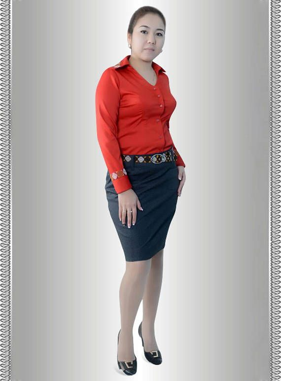 The luxurious scarlet matte stretch satin office blouse is a must have in every fashion-conscious-working lady's wardrobe. The specialty of the material is that it drapes around the curves of a women beautifully without being too clingy. This piece of garment-has the potential to add a sparkle of class to any office jean or skirt instantly. Get this beauty to outshine the fellow female colleagues at work.   The unique appeal of our clothing is a reflection of You: professional, elegant…