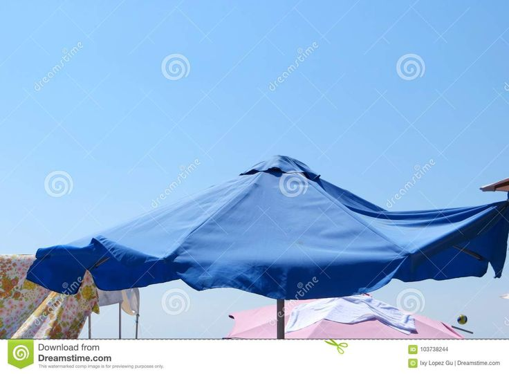 Blue Umbrella In A Sunny Beach Day - Download From Over 68 Million High Quality Stock Photos, Images, Vectors. Sign up for FREE today. Image: 103738244