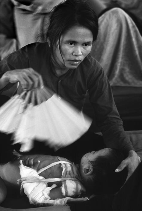 Mother with wounded child, Vietnam ca. 1967 by Philip Jones Griffiths. S)