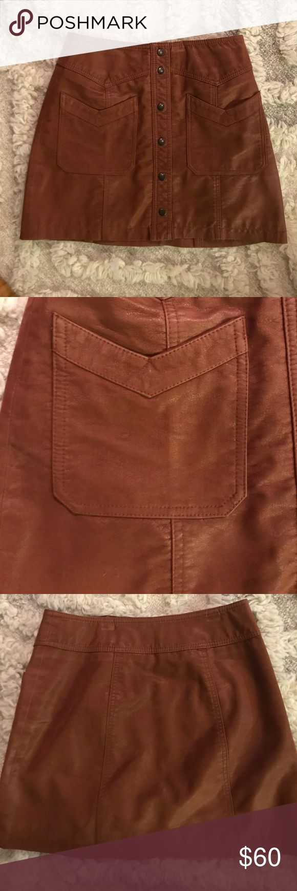 Camel Free People Leather Skirt Leather mini skirt with gold buttons and chevron pocket accents. Fits high waisted, awesome pair with a crop top or a black turtle neck tucked in for a sleeker look! Free People Skirts Mini