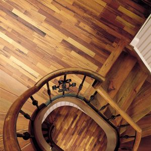 Staircase flooring idea : Cambridge - Merbau by Shaw Hardwoods Flooring    Maybe something like this would coordinate with the dark railing?